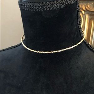 Jewelry - Choker in gold with silver tassels
